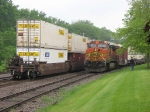 100611015 Westbound BNSF intermodal (Stacks, TOFC, COFC) meets eastbound BNSF Bare Table pipe flatcar train
